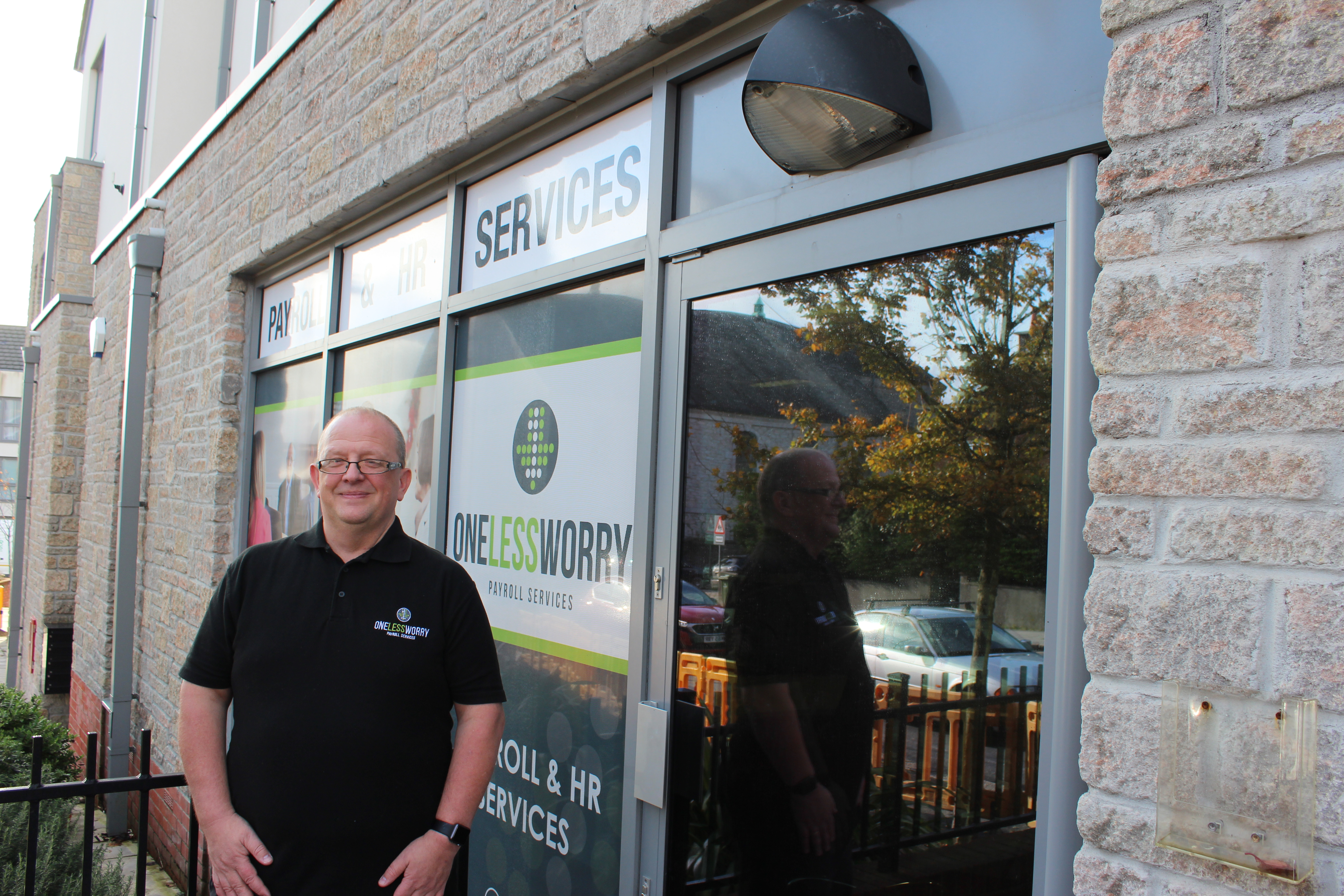 James Toulson, owner of One Less Worry, standing by his window films