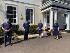 Staff wearing visors at Primley House, Paignton