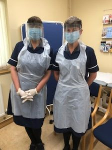Staff wearing visors at St Levan Surgery, Plymouth